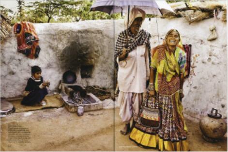 Vogue India août 2008, paysan avec un parapluie Burberry.